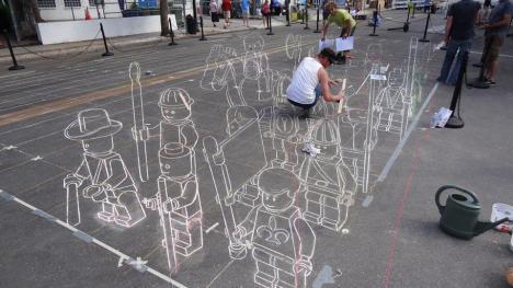 Cool gatumålning visar LEGO-figurer i 3D